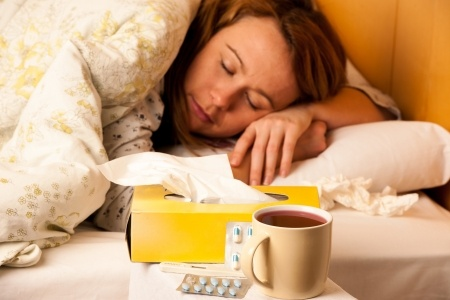 25246583 - sick young woman resting in bed